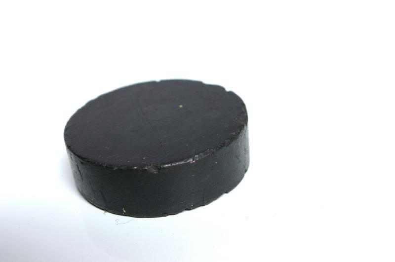 A hockey puck against a white background